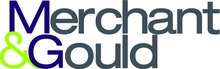 "two lines of text beginning with a purple letter and followed by gray letters with a bright green ampersand in front of line 2, reading ""merchant & gould"" logo"