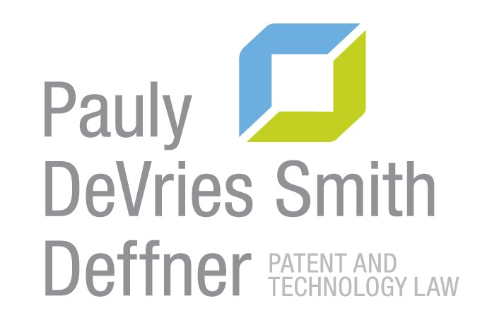 "gray text in four lines reading ""pauly devries smith deffner"" to the left of a square comprised of a blue and green V logo"