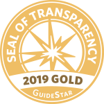 "round gold seal with a white star in the center that reads ""SEAL OF TRANSPARENCY 2019 GOLD GuideStar"""