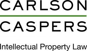 black sans serif all caps font two lines separated by a green line reading CARLSON CASPERS logo