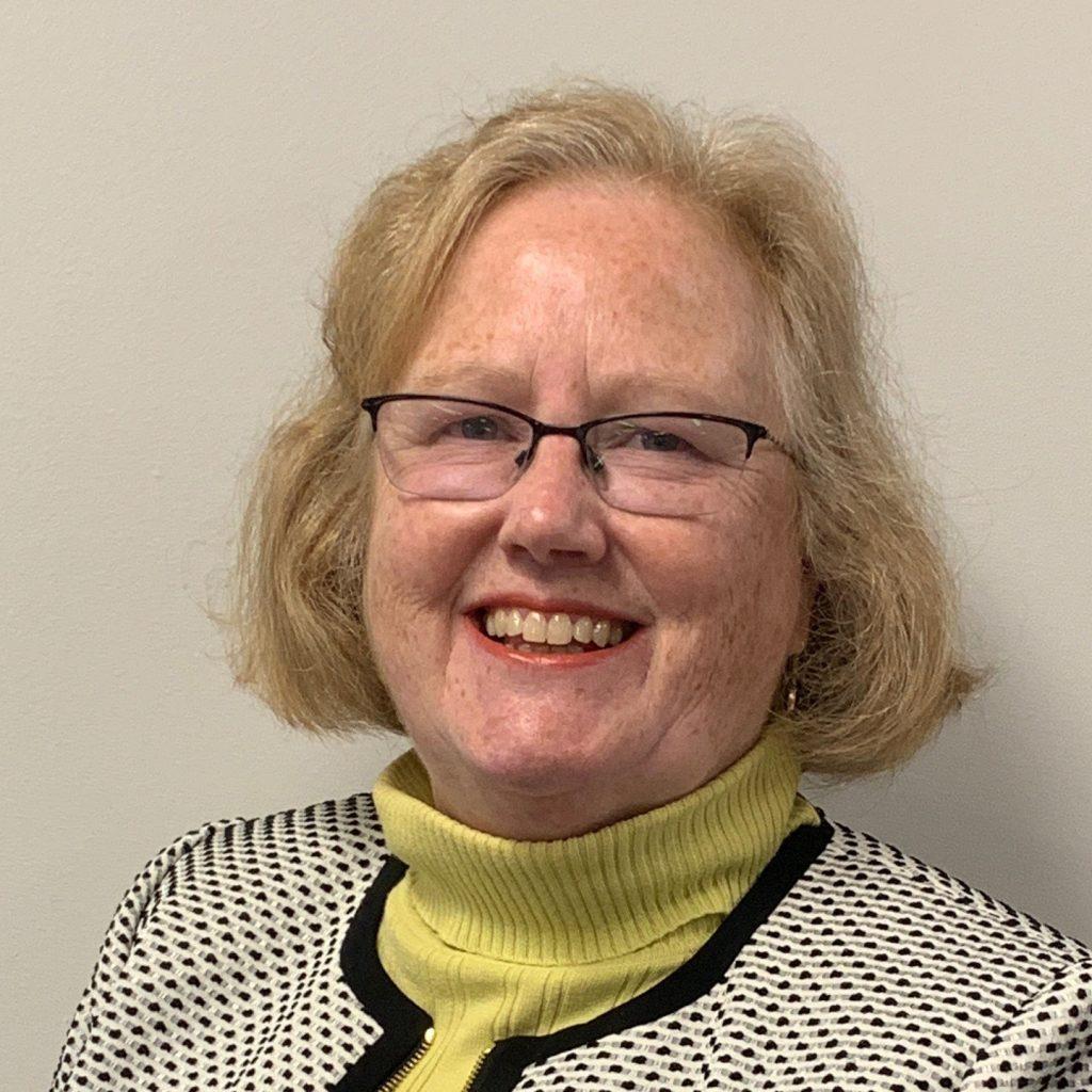 photo of woman smiling at camera