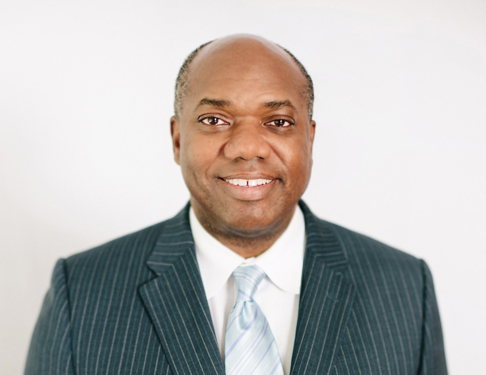 smiling man in a business suit